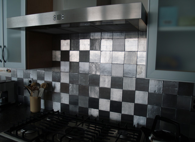 Bonus Tip: Use Metal as a kitchen backsplash, it's easy to install ...